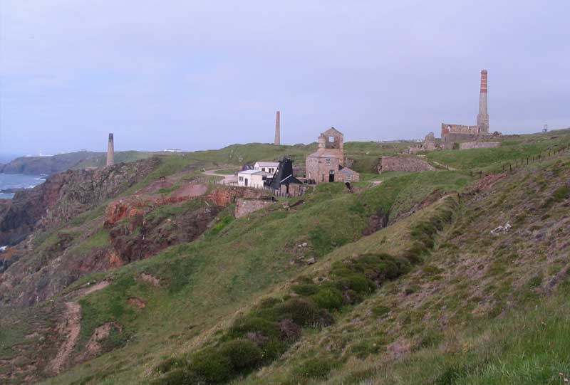<br>Levant Mine from the south showing the leat in the foreground, left to right the calciner, stamps and compressor stacks and the whim and pumping engine houses in the centre with the Skip Shaft headframe., Penwith Local History Group