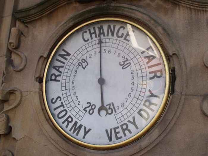 Old barometer showing a max of 31 inches of mercury as top of the scale