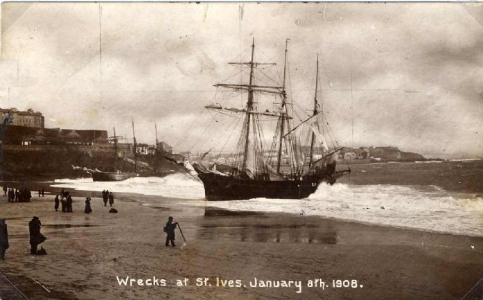 A view of ships being battered by the weather on the beach with Pedn Olva on the left (St Ives Archive)