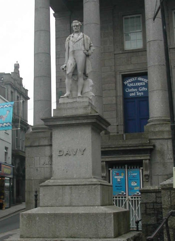 The statue of Sir Humphry Davy holding his miner's lamp, Market Jew Street, Penzance