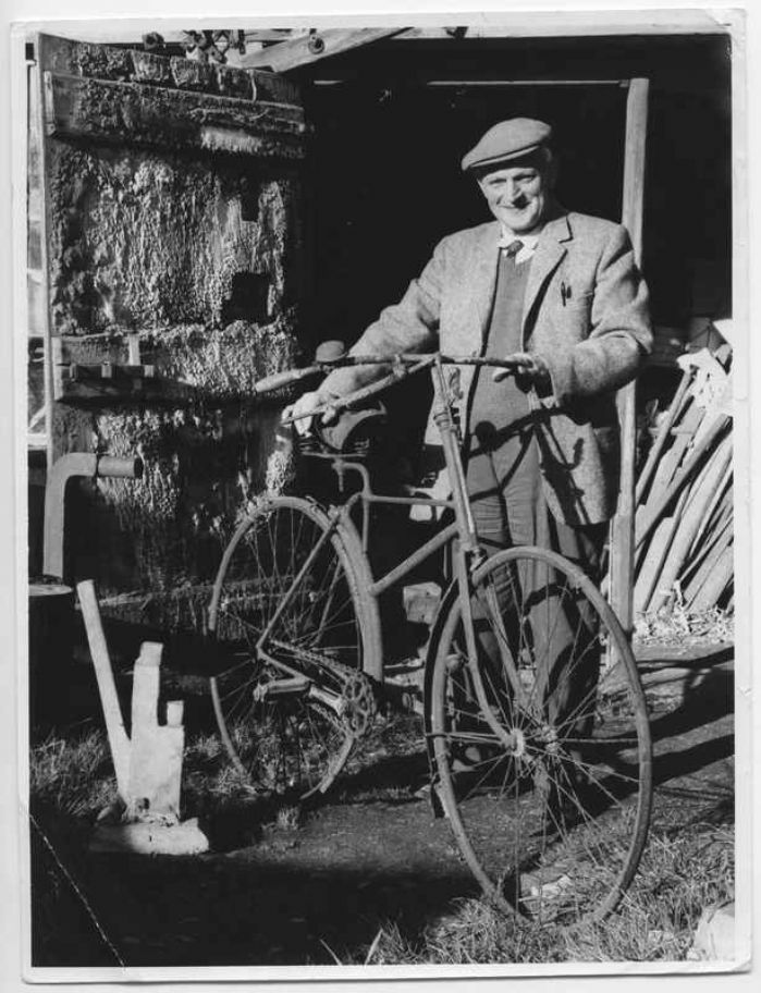 Milton Nichols of St Erth with his father's bicycle, solid tyres, prominent bell and a pretty aggressive looking brake which operates on the front wheel (courtesy of Morrab Library Photo Archive)