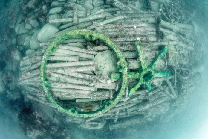 Underwater shot of the cargo mound with the wheel rim and spokes highlighted (photo courtesy CISMAS)