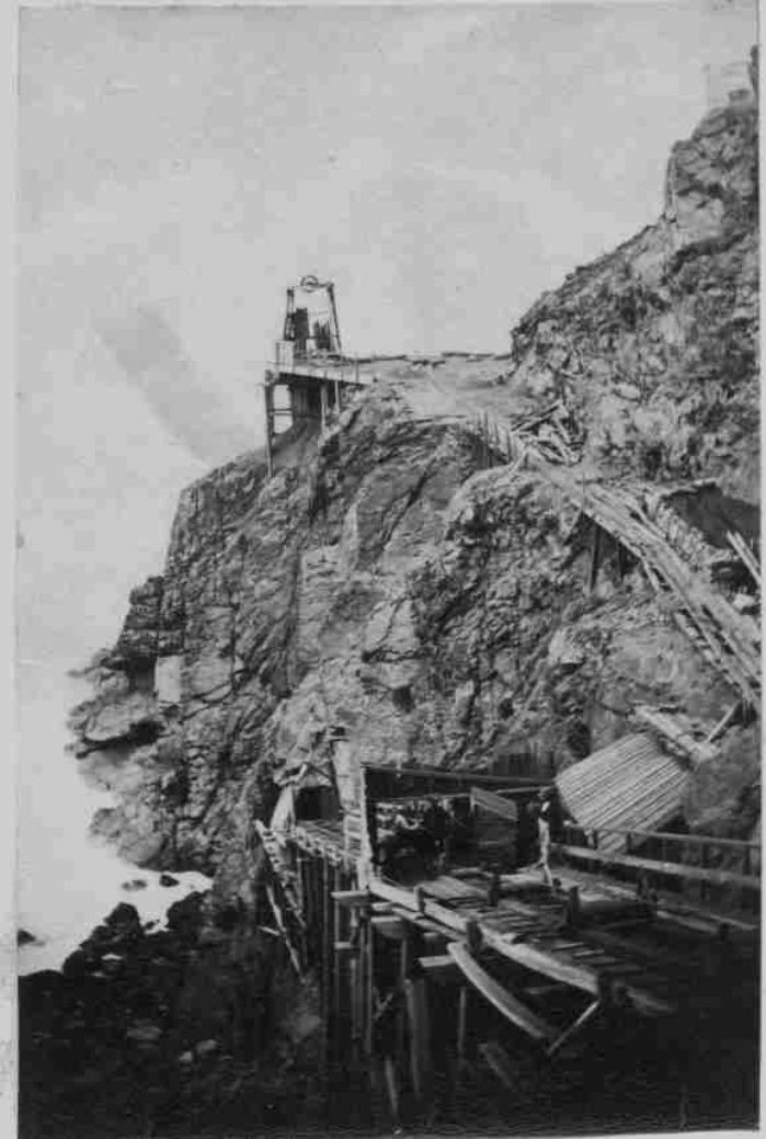 An early picture of the incline going down into the Crowns Mine, possibly while the trestle was being completed in 1862. This the route most of the visitors took into the mine until the Crowns was abandoned in 1874. Also shown is Wheal Button headframe. (photo Malcolm McCarthy Collection)
