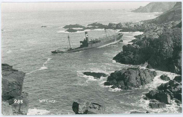 William Cory aground below Boscaswell Cliff. This must be some days later as there is no timber to be seen as she has turned around with her stern on the rocks. (photo Morrab Library Photo Archive)